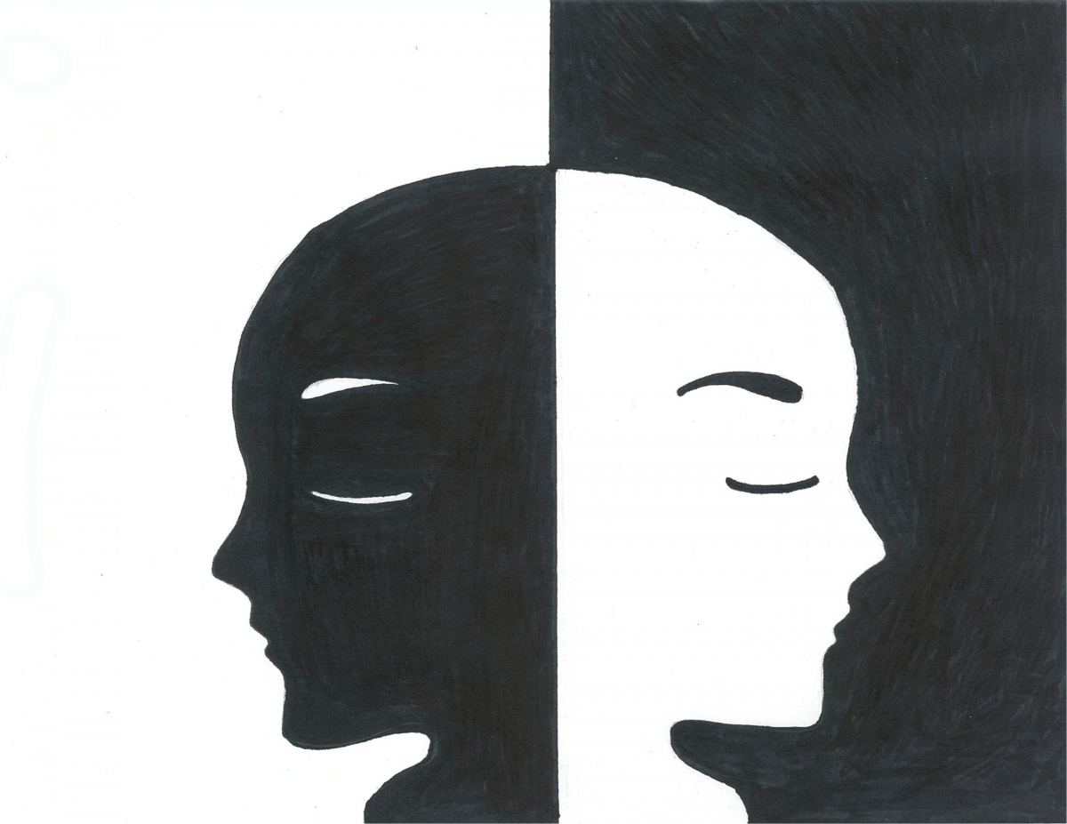 Two different coloured faces looking left and right, created by Lacey Brown
