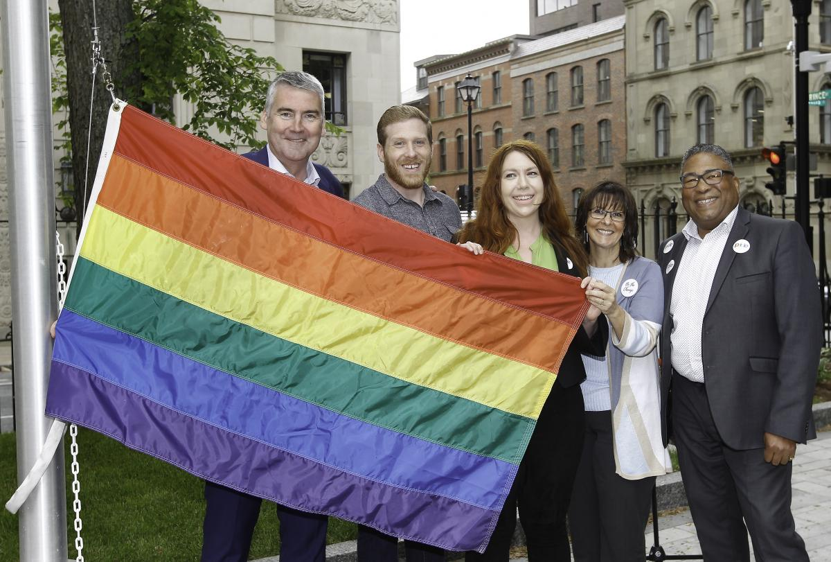 officials at the pride flag raising event